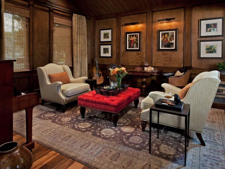 Sophisticated Yet Cozy Study - A bright red ottoman that doubles as a coffee table keeps this wood-paneled study from being staid and boring.