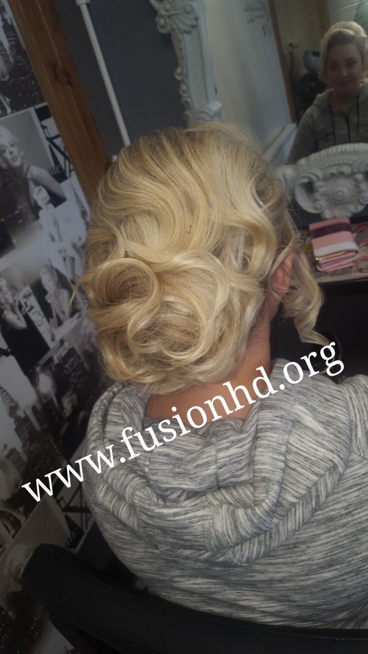 Soft up do perfect for a wedding with soft loose curls styled into a large bun #fusionhd