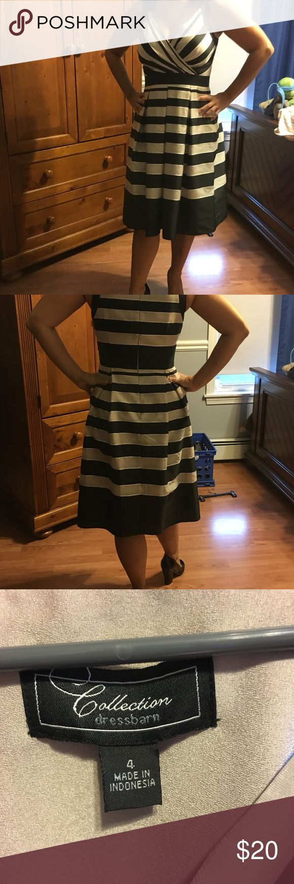 Beautiful like new Black/beige lined dress Beautiful Black/beige dress worn once for a wedding flattering style machine wash fully lined shoes for sale bundle for a deal.  Washed some slight discoloration under arm area from deodorant see pics not noticeable when on I'm 5'1 hit just below the knee Dress Barn Dresses Midi