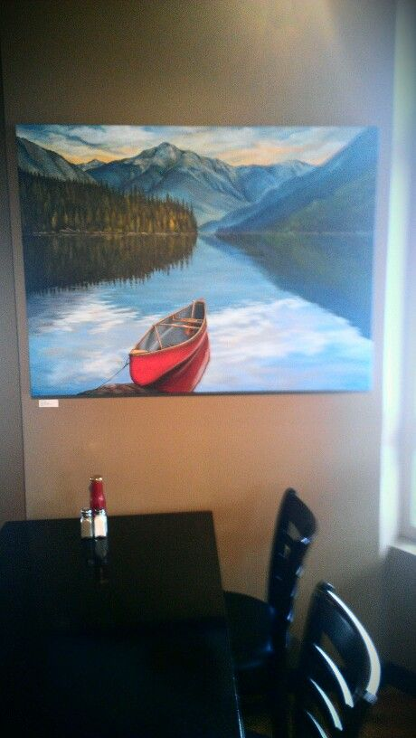 Red Canoe in Lillooet Lake Painting by Karen Love at  table in Mile One Eating House at Pemberton Gateway Village.Suites