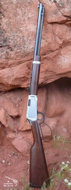 Lever action rifle, Henry Arms lever action rifle. Henry frontier with the large loop lever in silver. Red rock cliff in Kanab UT