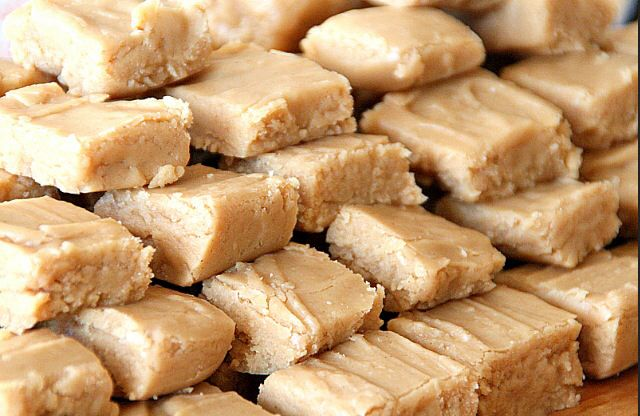 Easy Peanut Butter Fudge: 1 box of 10x sugar 1/2 cup evaporated milk  7 oz jar marshmallow  1lb 2oz jar peanut butter Mix sugar and milk and microwave for 5 min  Take that out and microwave jar of marshmallow without lid for 30 seconds Take that out and microwave peanut butter without lid for 45 seconds Mix and pour Into 9x13 pan and allow to harden.