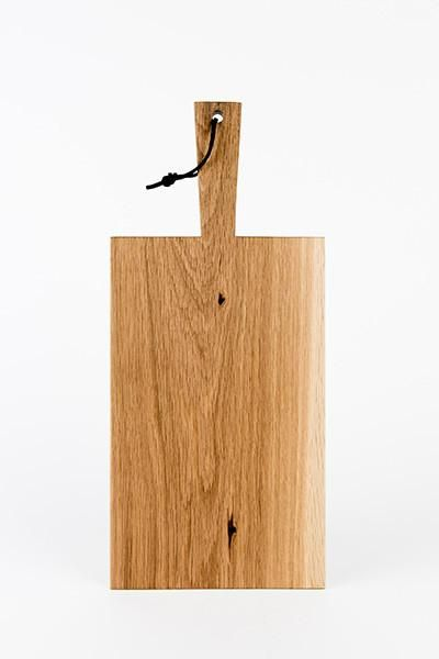 """Our traditional serving board is a clean and simple approach to serving your favourite foods. Each board is made by hand and features a 6"""" handle with a leather strap for hanging."""