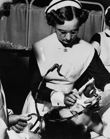 """""""Nurse Preparing Patient for Shock Therapy."""" Modern methods of electro-convulsive therapy, used to shorten periods of depression, are applied here to patient """"Abbe"""" who has been committed to a mental hospital for emotional stress. November 20, 1951"""