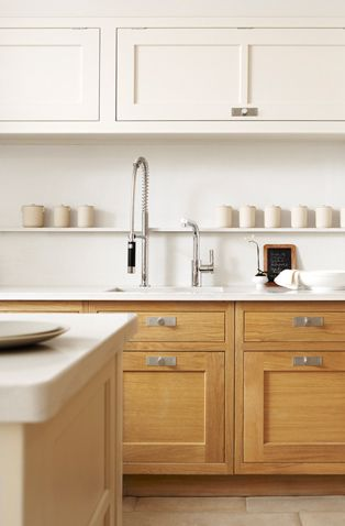 I like the wood shaker below and creamy white above, with white counter and white tile walls.