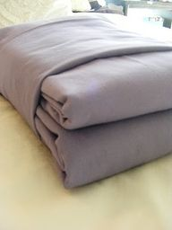 How to Fold Fitted Sheets by imperfecthomemaking: Neat packages that actually sit pretty on linen closet shelves. #Folding_Fitted_sheets