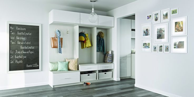 #TIP: Make the most use of vertical space in a mudroom with hooks for jackets and custom drawers and baskets to stash shoes and other seasonal gear. #Mudroom #Organized #CaliforniaClosets #Design