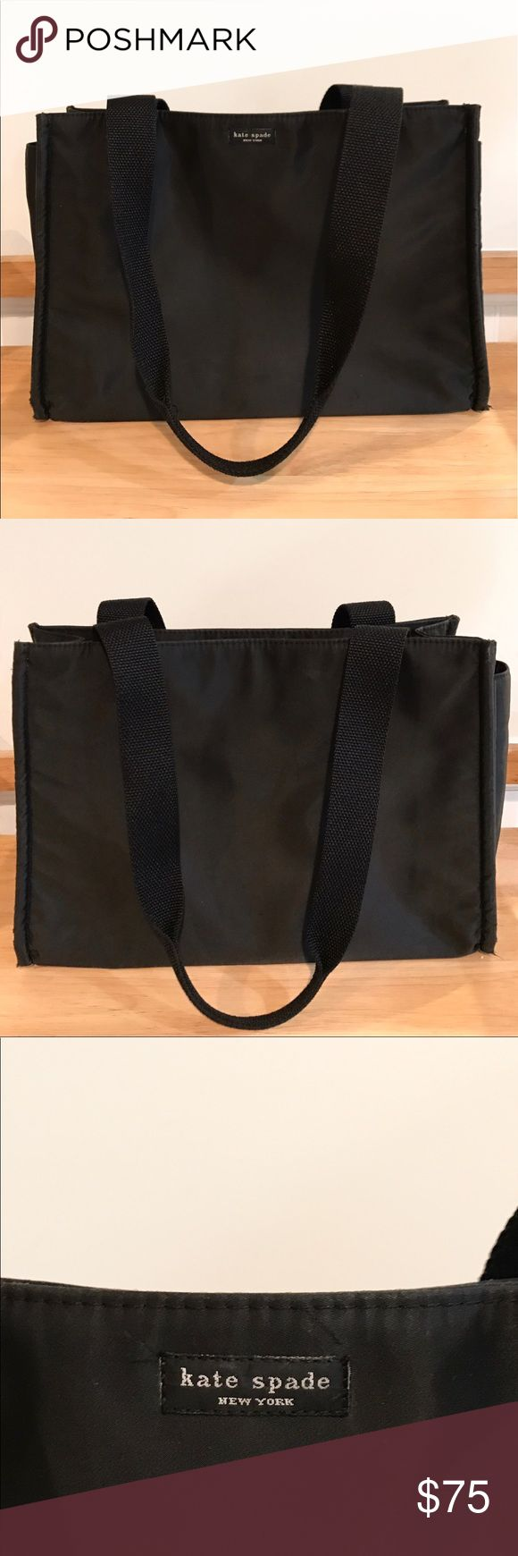 """Kate Spade Black Tote Bag Large Black Kate Spade Nylon Tote. 100% Authentic in Good Condition. Zippered close and additional zippered pocket inside. Can be used for travel, or as a diaper bag. Two side pockets for storage. Minor wear and tear (see corners). Approximately 5"""" wide, 14"""" long, 10"""" tall, with a """"10 strap drop. kate spade Bags Totes"""