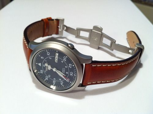 Seiko 5 automatic+Panatime leather strap. I'm pretty sure this will be my next watch. Its a automatic 21 jewel movement. 100mm depth, crystal face. Comes with a canvas strap, but adding a leather one like the one pictured makes it. Everthing all together, $150