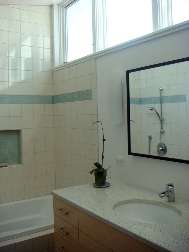 The Bathroom Features Recycled Countertops By Icestone Low Flow Sink Faucet And Croma E 75 Shower Fixture Visible In Mirror Are Hansgrohe