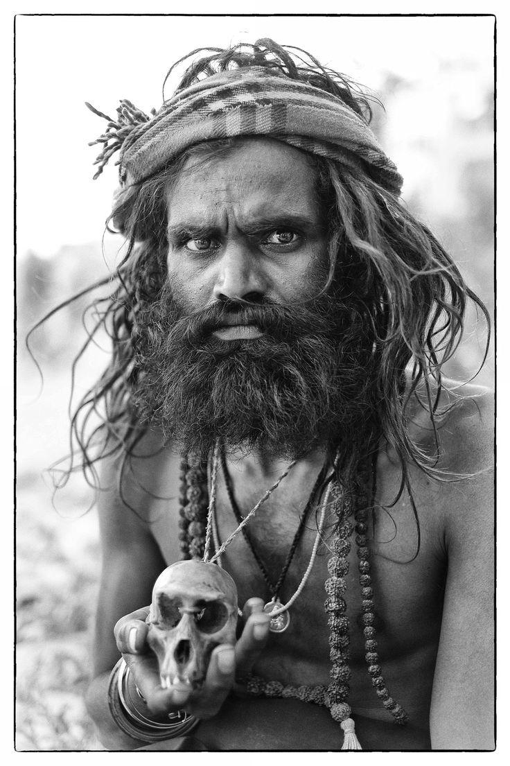 An Aghori sadhu sits by the Ganges River in Varanasi, India.