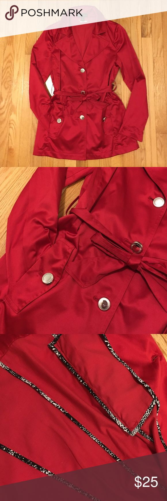Red Trench by Dana Buchman Excellent condition lightweight red trench coat. Worn once! Satin like finish. 55% polyester and 45% cotton. Dry clean only. Super nice contrast print bias finishings on the inside. Front pockets. Button front and belt tie. Dana Buchman Jackets & Coats Trench Coats