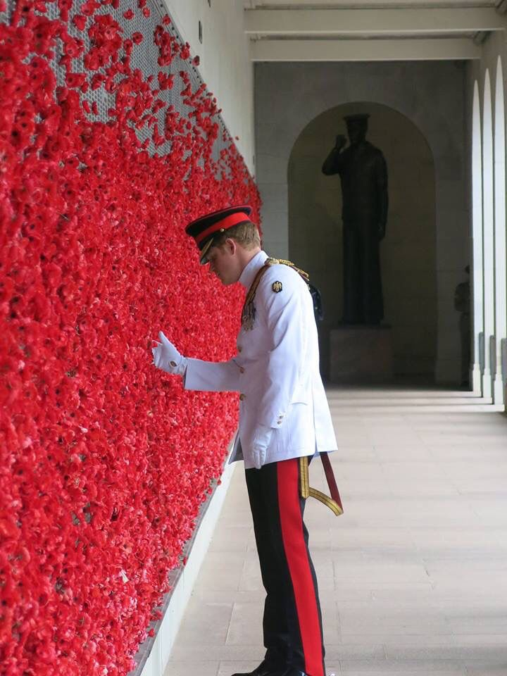 Prince Harry places a Poppy at the Australian war memorial