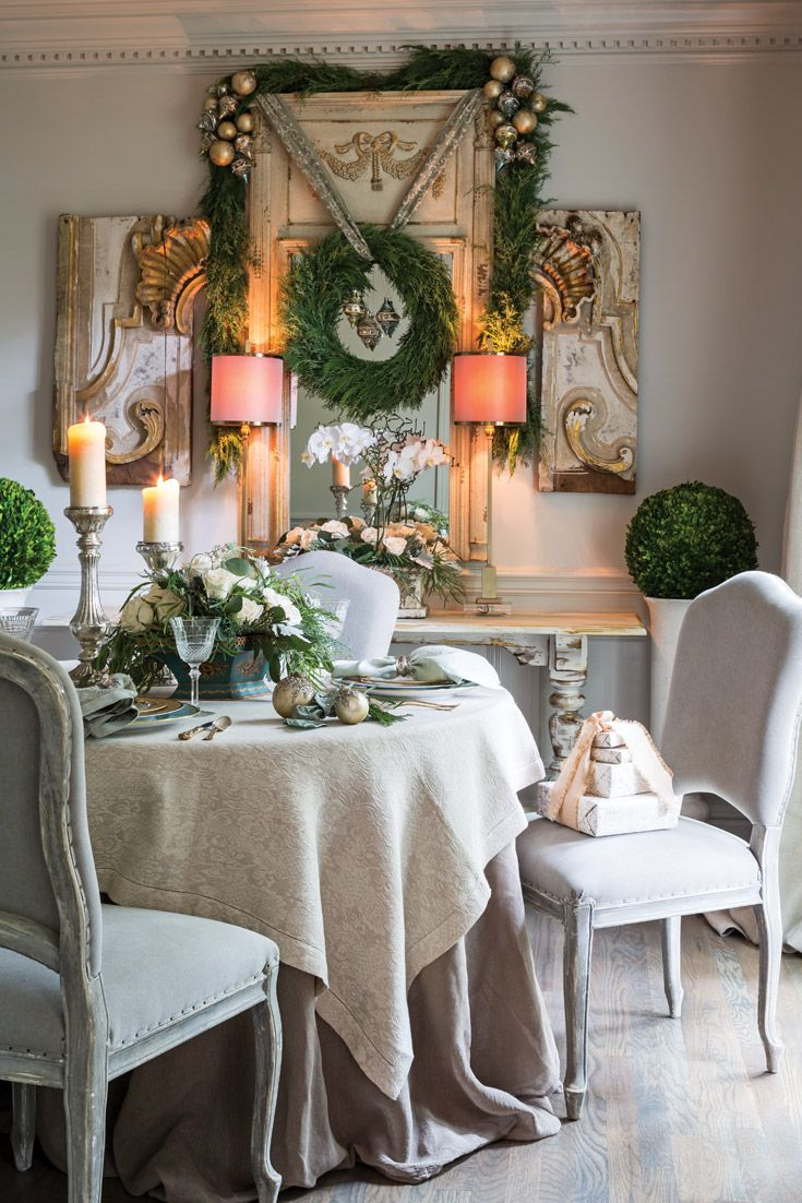 A serene yet festive dining space showcases fresh-cut greenery and prized keepsakes.