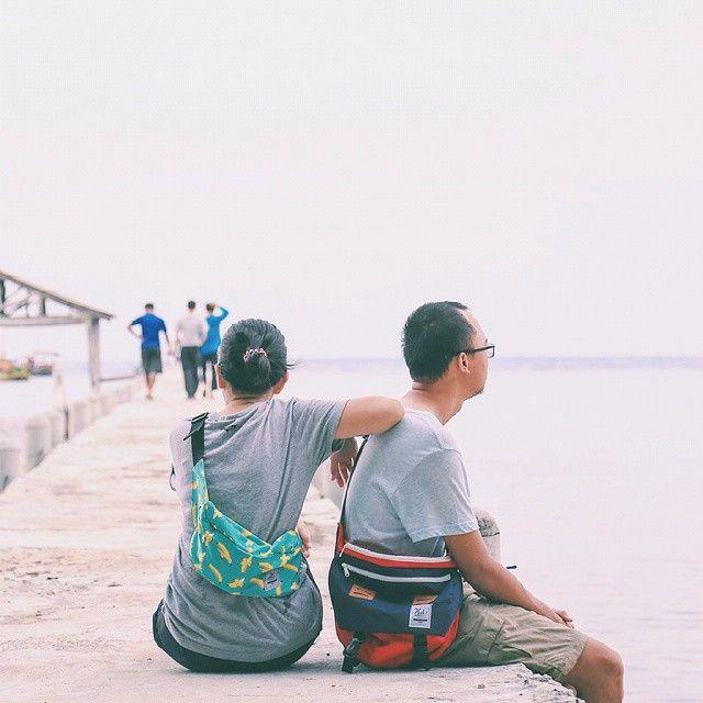 Exploring dock side and found a new vantage point of Photography and excitement with Cub Traveler Bags (left; Waist Bag Banana, right; Messenger Bag Red-Navy), #bags #messengerbag #waistbag #products #outdoors #modernoutdoorsman #traveling #traveler #dock #vacation #holiday #jalanjalan #exploreindonesia #explorebandung #slingbag