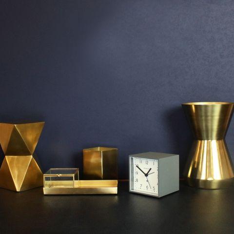 The Cubic alarm clock by Newgate Clocks. A contemporary square alarm clock in dark grey. Lifestyle Image.