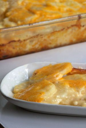 Easy potato dish thats real comfort food! Simple and rich, made fresh at home with common pantry ingredients. Never buy a box of Betty Crockers Scalloped Potatoes again! Easy to halve the measurements to make a 4 serving size.