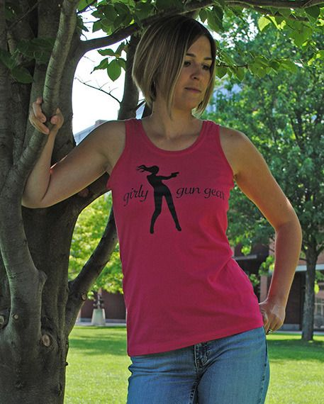 Sexy, fun and versatile this cotton tank is perfect for a hot day on the range or a great workout at the gym.  Features bold Girly Gun Gear graphic, a contoured fit and longer body length for added comfort.    8-oz, 100% combed cotton