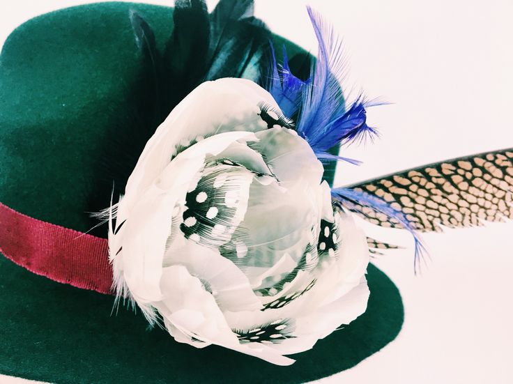 Cecile Millinery, details on hat  with feather flower , hand dyed , hand made in London