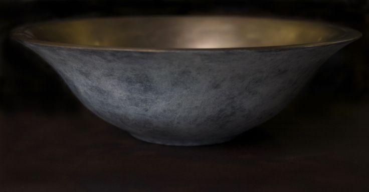 Round bronze basin with white patina