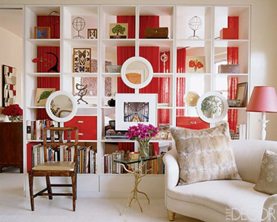 We spotted this open bookcase and curtain combo, designed by Klein, in the current issue of Elle Decor. Granted we might be particularly enamored with these photos since we clearly like the same color scheme, evidenced by our AT House Tour.    You could use the Ikea Expedit bookcase(s), along with a ceiling mounted curtain to create a similar, affordable version of Klein's high end design.