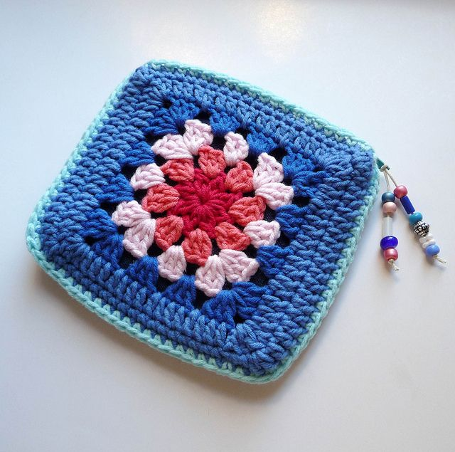 coin purse made of granny squares.  no pattern here but easy to hack.