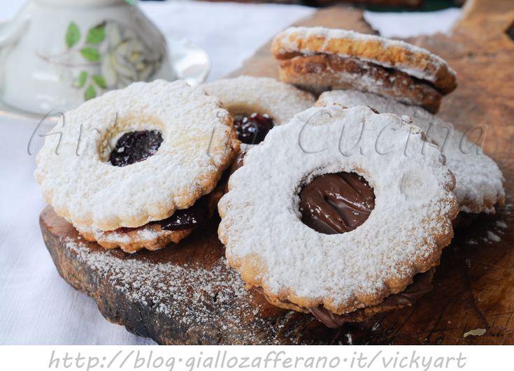 Biscotti occhio di bue ricetta facile, dolcetti da merenda, colazione, biscotti veloci farciti, nutella, marmellata, piccola pasticceria, dolcetti per il the, ospiti