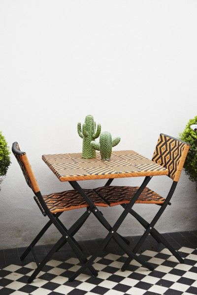 Charlotte's Mali Bistro Set in Mango Orange accessorised with Cacti. | MADE.COM/Unboxed