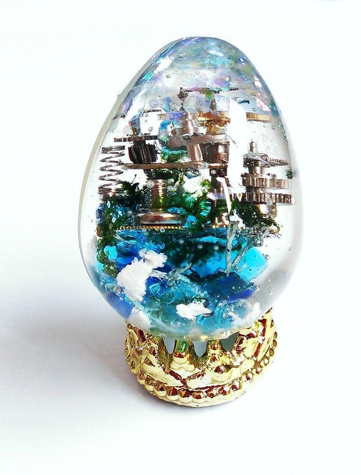 """レジンBOTさんのツイート: """"【レジン作品紹介】 時計パーツで作った小さな都市「ねじ島」。 空中に浮かぶ機械的な街はなんとも幻想的です。 製作者:@shihomi2525 https://t.co/5Ef1W5Jbpb"""""""