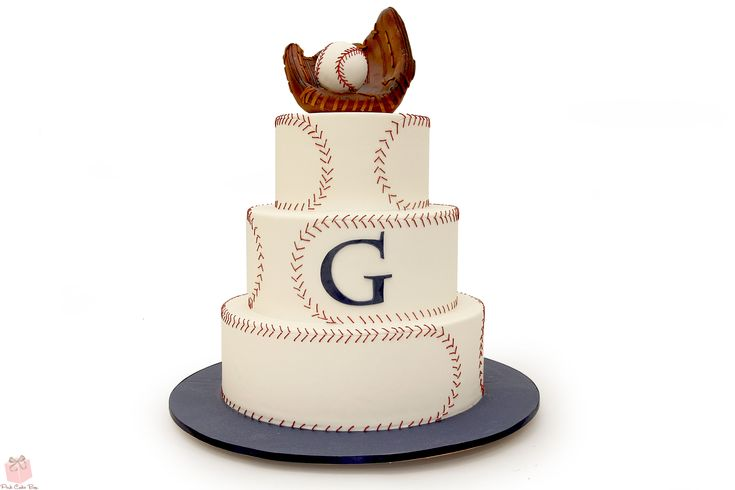 Elegance meets baseball in this three tier wedding cake complete with a baseball mit and red stitched baseball!