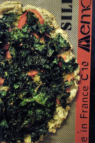 Kale Pizza - I added a bit of mozzarella and goat cheese too. So yummy ...