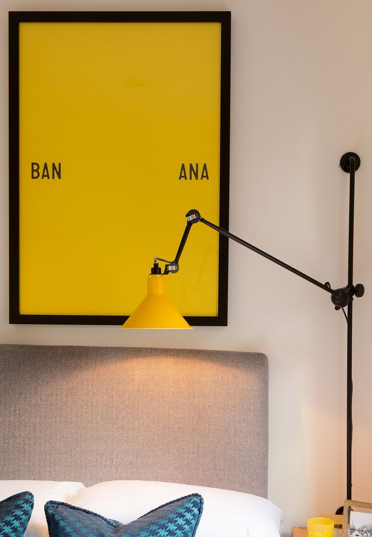 Buoyant and bold, we dressed this bedroom with vivid yellow and black accents to reflect the cool, vibrant Islington setting, the choice of quirky art adding contemporary flair.