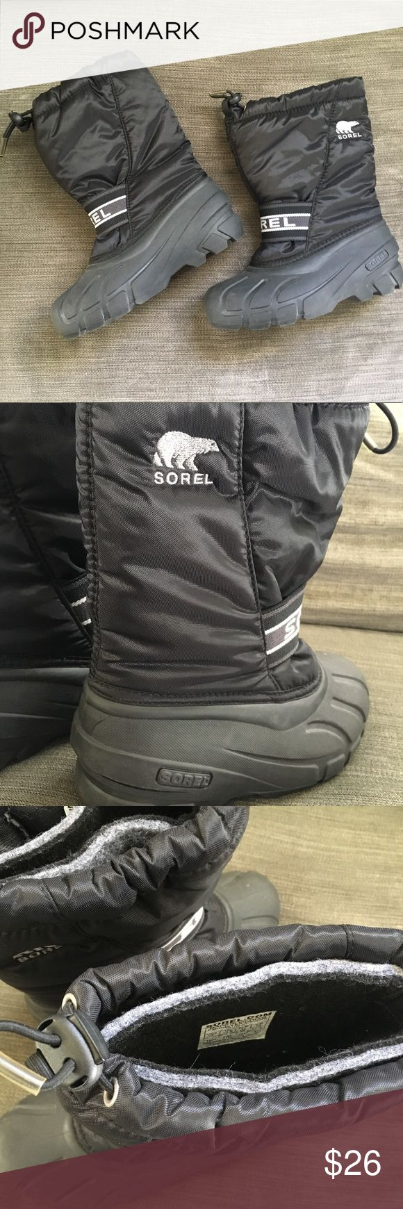 """Sorel Youth Snow Boots Sorel kids snow boots in black. Upper is water and wind resistant synthetic textile with a barrel lock closure and elastic instep strap. Outsole is waterproof rubber with multidirectional lugs for traction. Insulated by a removable and washable felt inner boot. Rated -25 degrees Fahrenheit. Shaft height 8"""", heel height 1"""". EUC! Sorel Shoes Rain & Snow Boots"""