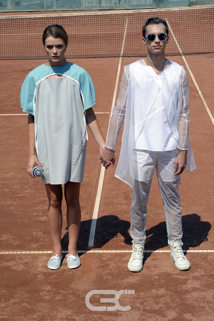 Lookbook: Him: Sheer blazer, white shirt, white and sheer pants. Her: White and teal dress. Tennis court, sport, sportswear, fitness, trends, unisex, campaign photos. Order via facebook, pm or e-mail.