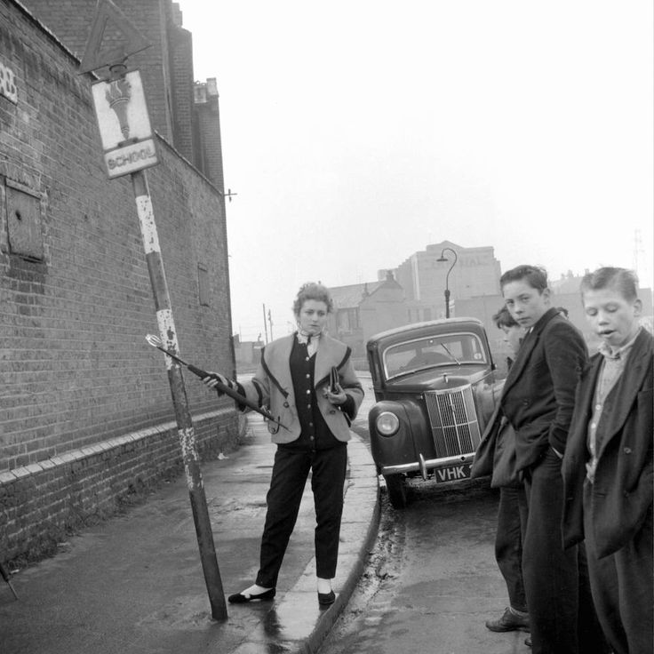 Photo by Ken Russell - January 1955 The last of the Teddy Girls Pat Wilson posing with umbrella aloft ©2006 TopFoto/Ken Russell