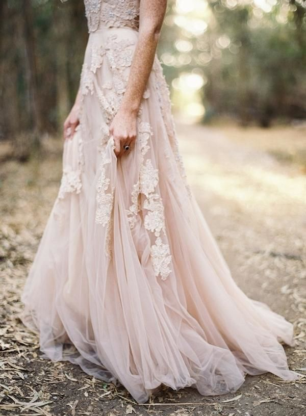 The embroidered lace on this blush wedding dress turns your typical tulle gown into a head turner. The washed out color highlights the details in a way that is truly magical for a boho chic summer wedding.