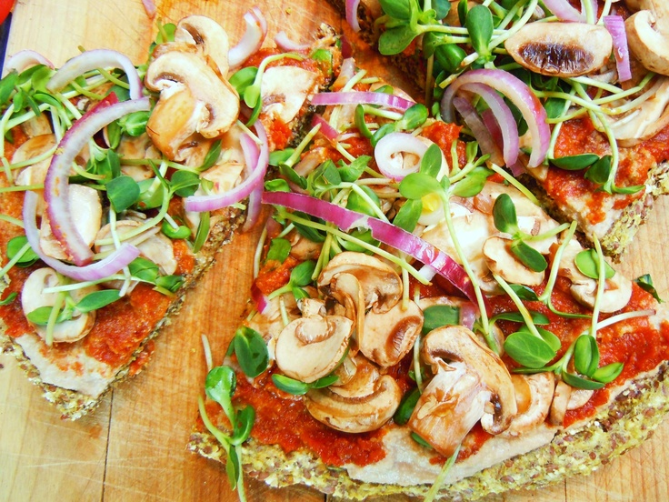 Vegan pizza on their famous flatbreads!  Mushrooms, sprouts, onions and sundried tomato puree on flatbreads made of raw cashews, sunflower seeds, ground flax and more.