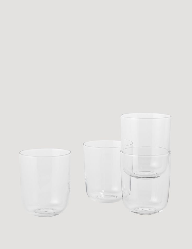 Sold in a gift box of 4 glasses. The CORKY carafe's oversized detail plays with the conventional bottle shape. Its simple yet characteristic design makes it ideal as a water jug or wine carafe and its large opening makes it easy to keep clean. The uncomplicated and light shape of the CORKY drinking glasses provide an interesting contrast to the oversized shape of the carafe. Great for everyday use and on special occasions.
