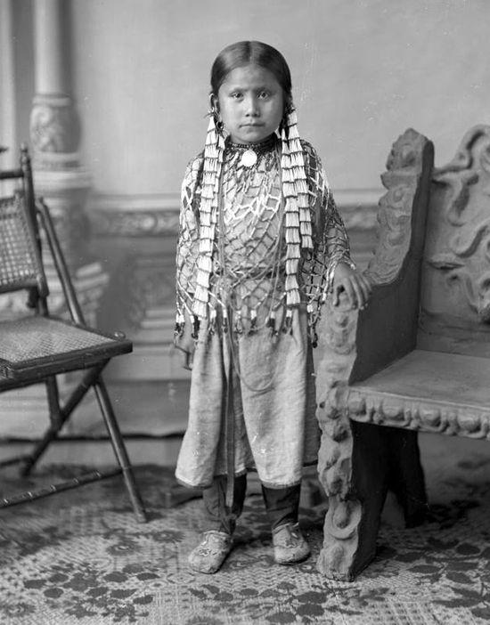 Sitting Bulls family ~ Standing Holy (Wakanyan Najin 1876-1926) at Seven years old.