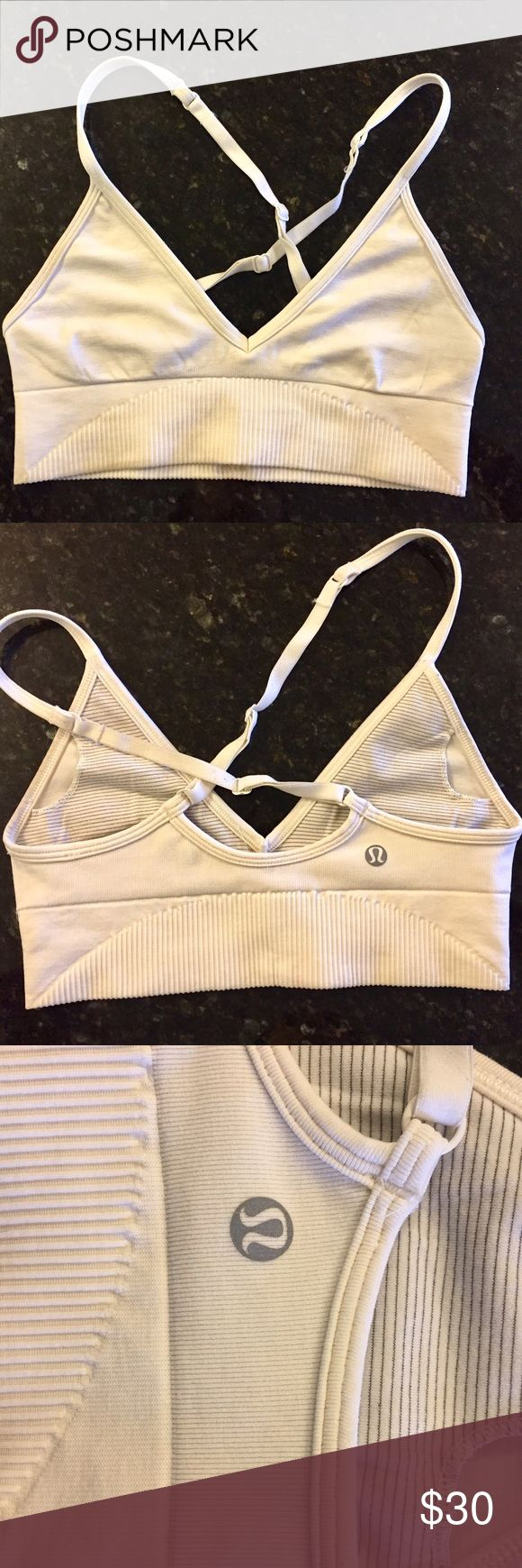 Lululemon Triangle Bra Sz 4, Cream This is a light support Bra from lululemon. Great for under tanks and tee shirts. Smooth look under shirts. There is some very mild discoloration but otherwise great condition. Go for gentle Pilates, light yoga, or to-from and lounging. Cream color. I cannot remember the actually name of this style. lululemon athletica Intimates & Sleepwear Bras