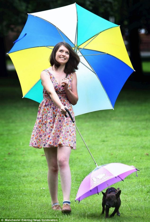 It's a dog's life! Charlotte Smith is almost as fashionable as her pet dog Jarvis and his snazzy purple brolly