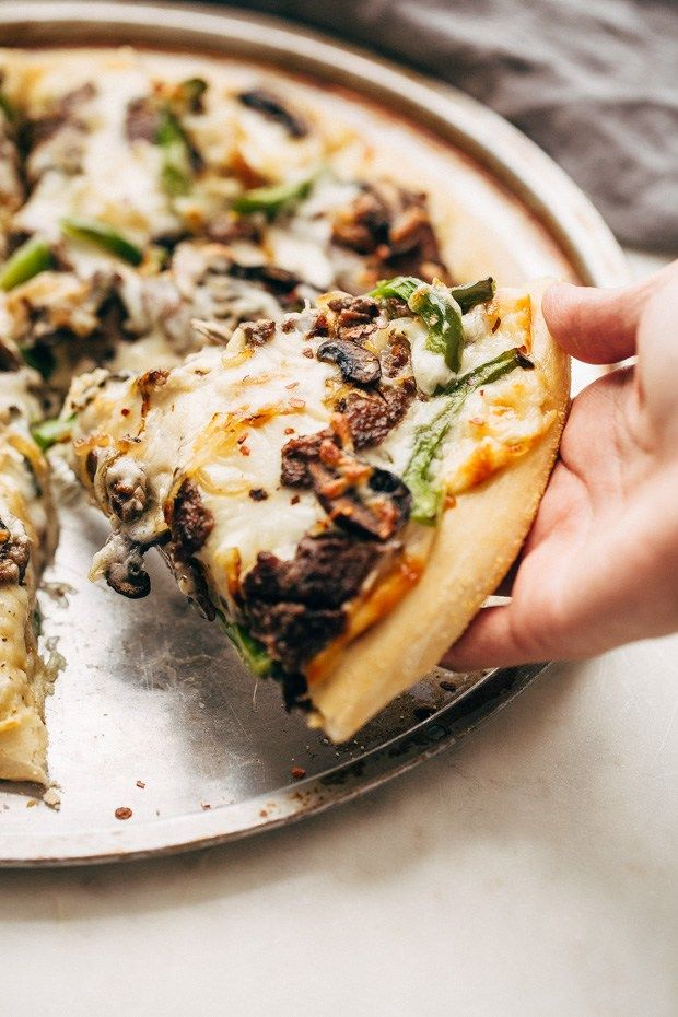 Philly Cheese Steak Pizza - Change up your Friday night pizza routine with a homemade Philly cheese steak pizza! Loaded with tons of veggies and meat, it's sure to be a crowd-pleaser! #pizza #phillycheesesteakpizza #steakpizza | Littlespicejar.com
