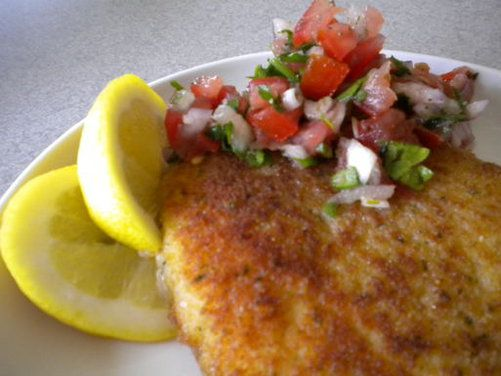 """My first introduction to squid steaks was about 30 years ago at The New Hellas Cafe in Detroit's Greektown.  The owner and my Dad grew up together and during our frequent trips, Gus would """"surprise"""" us with something he was cooking in the kitchen.  This particular night he came out with a breaded squid steak served with a little tomato and onion relish...it was so good that I had to make it myself.  I tinkered a bit ( since I wasn't given the recipe) and came up with this.  Gus closed his…"""