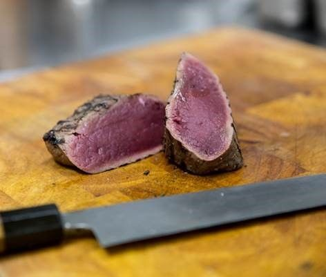 Chargrilled venison with spiced cherry sauce