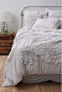 What a lovely bed set, but I think it looks raggedy in