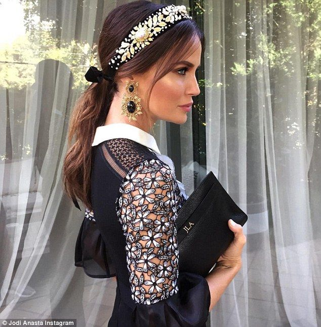 Self-Portrait jumpsuit with a stunning headpiece designed by celebrity milliner…