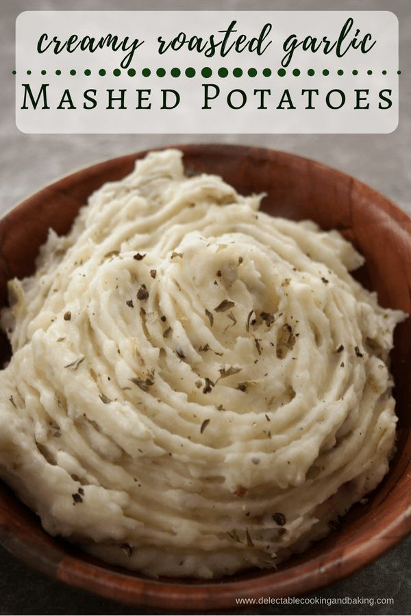 This Creamy Roasted Garlic Mashed Potatoes Recipe will be your new go-to recipe for mashed potatoes! These mashed potatoes are so creamy and  roasted-garlic-delicious, that there are never any leftovers! DelectableCookingandBaking.com | #mashedpotatoes #c