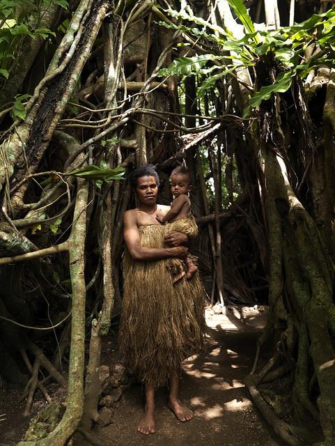Mother and baby living in a banyan tree, Vanuatu Efate , Vanuatu, a house build into a giant banyan tree Vanuatu, former New Hebrides © Eric Lafforgue www.ericlafforgue.com