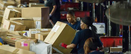 Sorting parcels at a FedEx Express centre