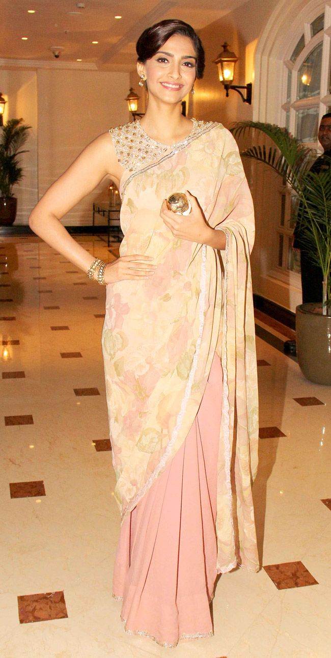 Sonam Kapoor in a simple yet stunning floral sari by Shehlaa with a blouse that showed off her toned back.